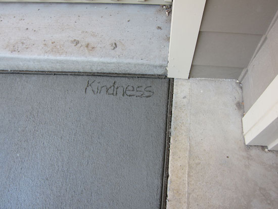Image of the word Kindness written on my driveway.  ©2012 Lisa Cal, Textile Artist, Denver, Colorado